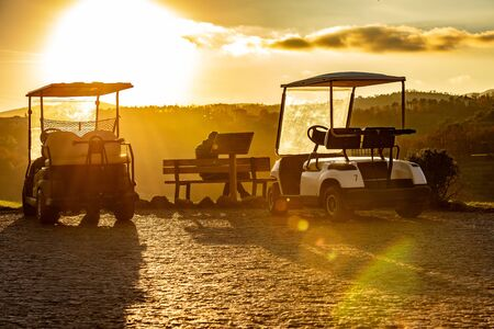 Caddy golf car at the sunset