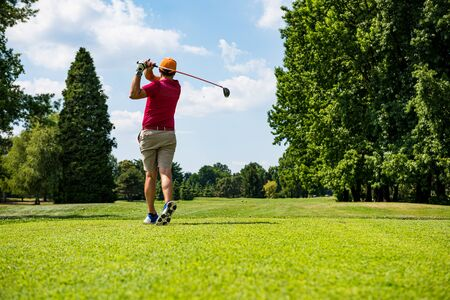Hitting the perfect golf shot Stockfoto