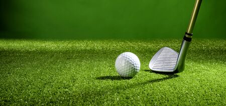 golf ball with golf club Imagens