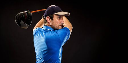 Portrait of a golf player perfecting the swing isolated on dark background, banner image