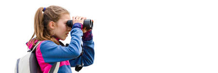 Young girl looking through binoculars at birds, isolated on white background. Banner image. Bird watching tours. Ecotourism concept image travel. Banco de Imagens