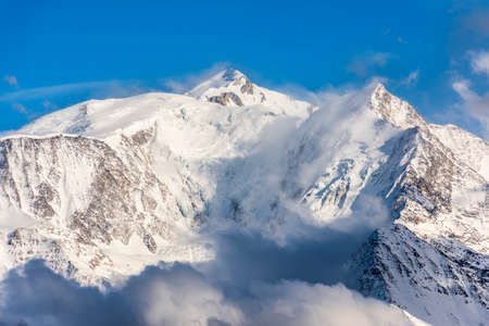 Ski slopes under the Mont Blanc massif in winter on a sunny day