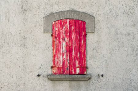ancient closed red window
