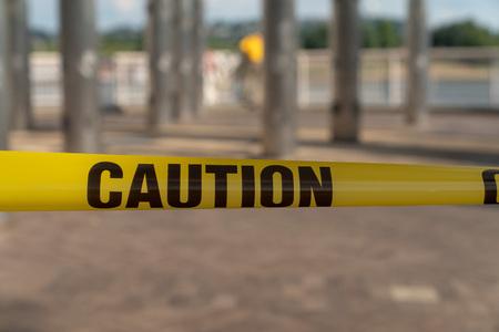 Caution tape at a festal up close