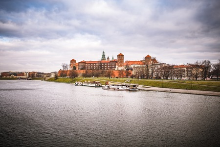 Fantastic view of the autumn KRAKOW. The Royal Wawel Castle as seen from another bank of Vistula in Krakow, Poland, Europe Editorial
