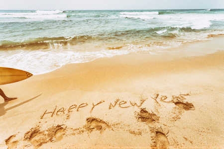 New Year text on the sea beach. Retro vintage.