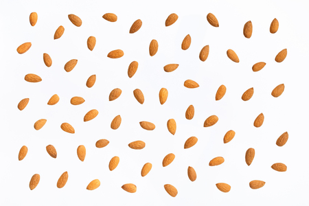 Nuts pattern - almonds on white background. Concepts about decoration, healthy eating and food background. Stock Photo - 87985118