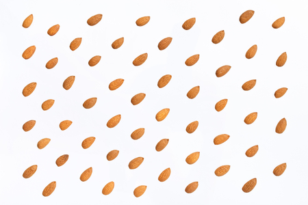 Nuts pattern - almonds on white background. Concepts about decoration, healthy eating and food background. Stock Photo