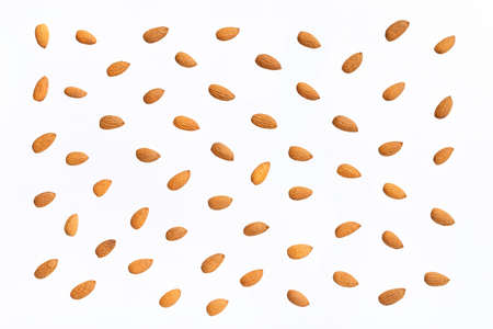 Nuts pattern - almonds on white background. Concepts about decoration, healthy eating and food background. Stock Photo - 87985129