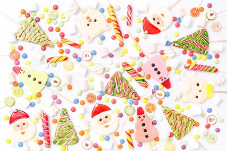 Lollipops sweets. Candy, top view flat lay on white background. Sweet sucker, lollipop, candy, food background Stock Photo