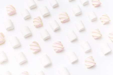 Pattern sweet marshmallow, candy on white background, top view flat lay. Isolated minimal concept above decoration, view white marshmallow, food background Stock Photo - 87985050