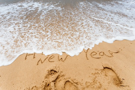 Happy New Year 2017 replace 2016, lettering on the beach Stock Photo