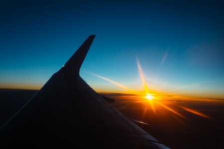 travel sunset view from the window of an airplane, vintage filter effect Stock Photo
