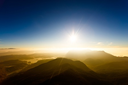 Sunset in the mountain landscape. Young freedom on mountain peak. Stock Photo