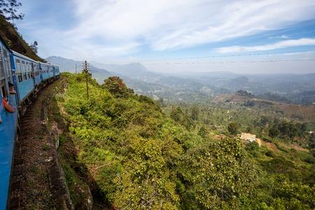 Nuwara Eliya, SRI LANKA, Southern Asia - February 07, 2016: Train from Nuwara Eliya to Kandy among tea plantations and mountains. Sri Lanka Editorial