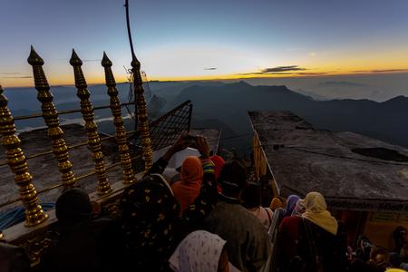 Sri Lanka, Southern Asia - February 14, 2015: Sunrise greeted pilgrims on the holy mount Adams Peak ( also Sri Pada ) is the most popular pilgrim place in Sri Lanka Stock Photo