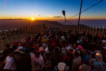 Sri Lanka, Southern Asia - February 14, 2015: Sunrise greeted pilgrims on the holy mount Adams Peak ( also Sri Pada ) is the most popular pilgrim place in Sri Lanka Editorial