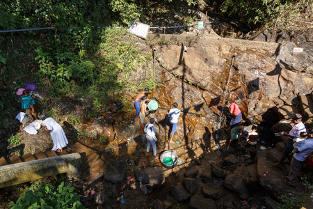 Sri Lanka, Southern Asia - February 14, 2016: Bathing pilgrims after climbing the sacred mountain Adams Peak