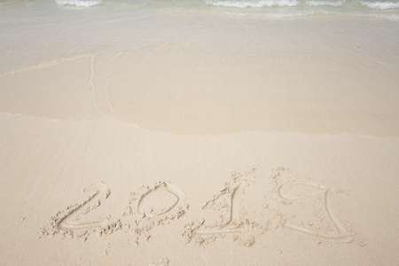 Happy New Year 2019, lettering on the beach. Stock Photo - 110787213
