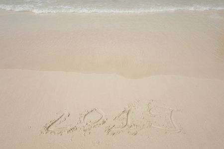 Happy New Year 2019, lettering on the beach.