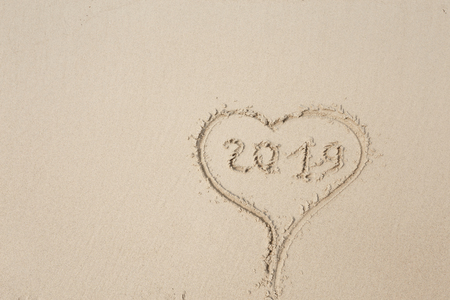 Happy New Year 2019, lettering on the beach. Stock Photo - 110787221