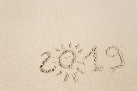Happy New Year 2019, lettering on the beach. Stock Photo - 110787222