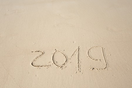Happy New Year 2019, lettering on the beach. Stock Photo - 110787220