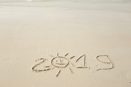 Happy New Year 2019, lettering on the beach. Stock Photo - 110787151
