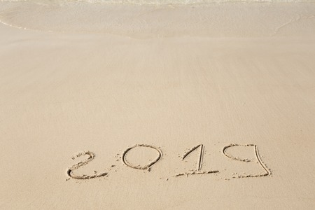 Happy New Year 2019, lettering on the beach. Stock Photo - 110787155