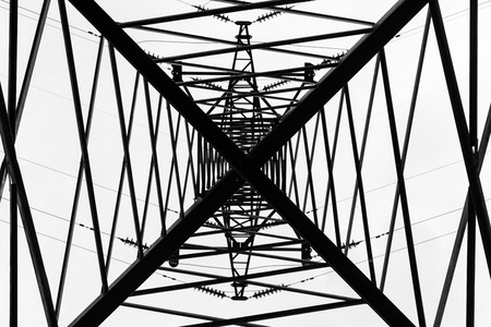 Under overhead high-voltage power line tower. View from bottom of construction Stock Photo