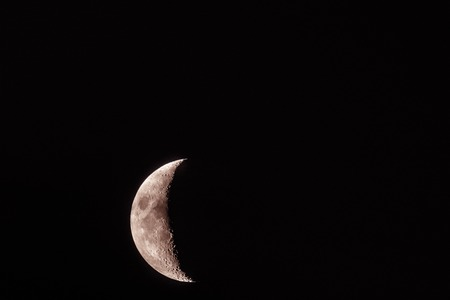 Half Moon close up. Astronomical body. Black deep cosmos space background. Copy space