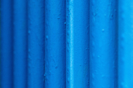 Many old blue pipes. Pipeline used in different industry ways - gas, water or vapor supply. Close up Stock Photo