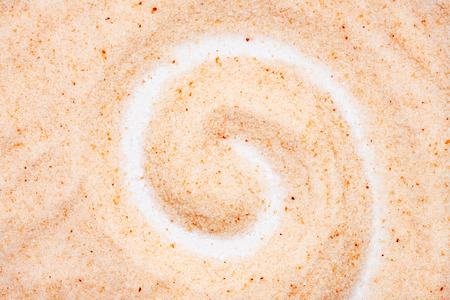 Himalayan salt, spiral shape, close up, macro, top view. Flavor food spice pinkish tint. Used for natural digestive aid, air purifier and sleep inducer