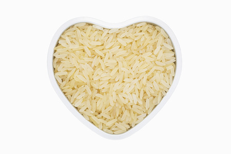 White rice steamed, heart-shaped, close up, isolated. Healthy nutrition for weight loss and controls diseases occurrence