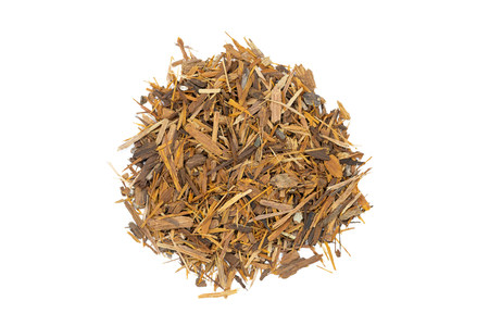 Catuaba bark tea, isolated handful. Natural herbal tea from powdered Catuaba tree bark. Brazilian aphrodisiac used as antidepressant, antioxidant and nervous system stimulator.