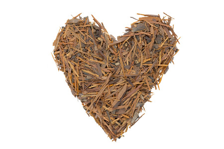 Lapacho herbal tea, heart-shaped, close up, isolated. Healthy South American tea drink used as natural antibiotic, anti-aging effect and boosts the immune system.