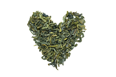 Huangshan Maofeng green tea, heart-shaped, close up, isolated. China yellow mountain famous green tea with a slight floral overtone. Tea used for lose weight and promotes blood circulation.