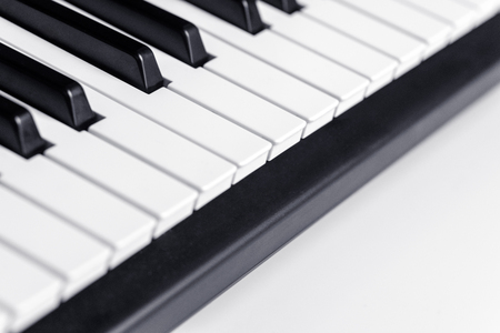 Piano keys with copy space, isolated. Piano or synthesizer keyboard. Classical music instrument for playing or composing romantic music.