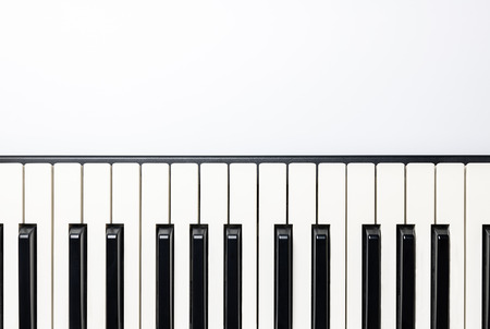 Piano keys with copy space, isolated for design, top view, flat lay. Piano or synthesizer keyboard. Classical music instrument for playing romantic music. Imagens
