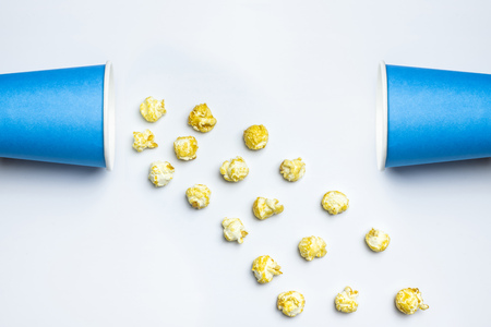 Popcorn sweet concept, copy space. Isolated white background. Delicious sweet popcorn for watching new movies in cinema. 版權商用圖片