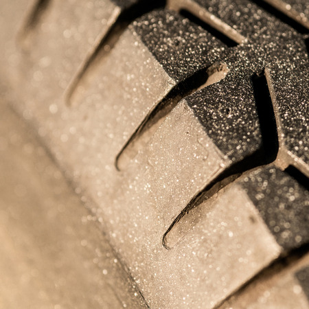 Old tread pattern for vehicle. Car wheel abrasion reduces safety. Close up photo Stock fotó - 122795241