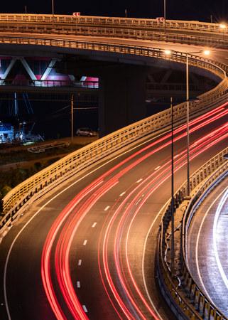 Interchange bridge road with car light streaks. Night light painting stripes. Long exposure photography. Stok Fotoğraf