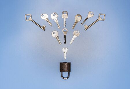 Key picking concept. Lock and different antique and new keys, blue background. Protection of business and house, real estate security.