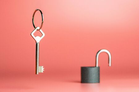 Key on keyring with open padlock, copy space. Anti thief concept of security and privacy data, car house.