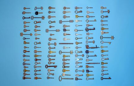 Keys set on blue background. Door lock keys and safes for property security and house protection. Different antique and new types of keys.