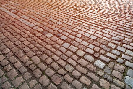 Old paving stones pattern. Texture of ancient german cobblestone in city downtown. Little granite tiles. Antique gray pavements. Stock Photo