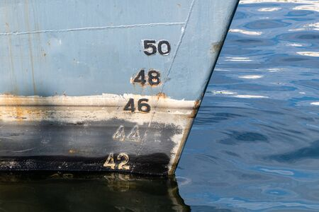 Old ship draft on hull, scale numbering. Distance between waterline and bottom keel.