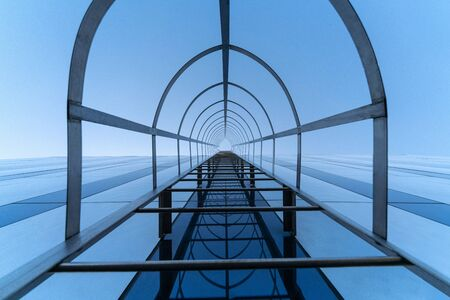 Fire escape staircase. Stairway to Heaven concept. Emergency fire exit. Bottom view Stock Photo