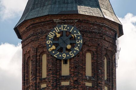 Clock tower of Konigsberg Cathedral. Brick Gothic-style monument in Kaliningrad, Russia. Immanuel Kant island.