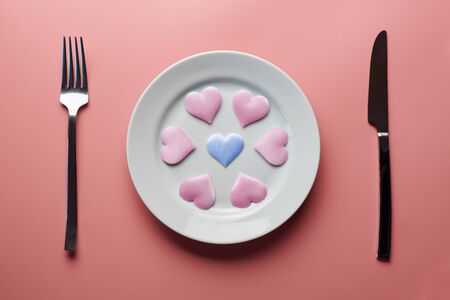 Hearts on plate. Woman and men love flirt. Choice among different sex partners. New girlfriend or boyfriend. Promiscuity and polygamy concept. Stock Photo